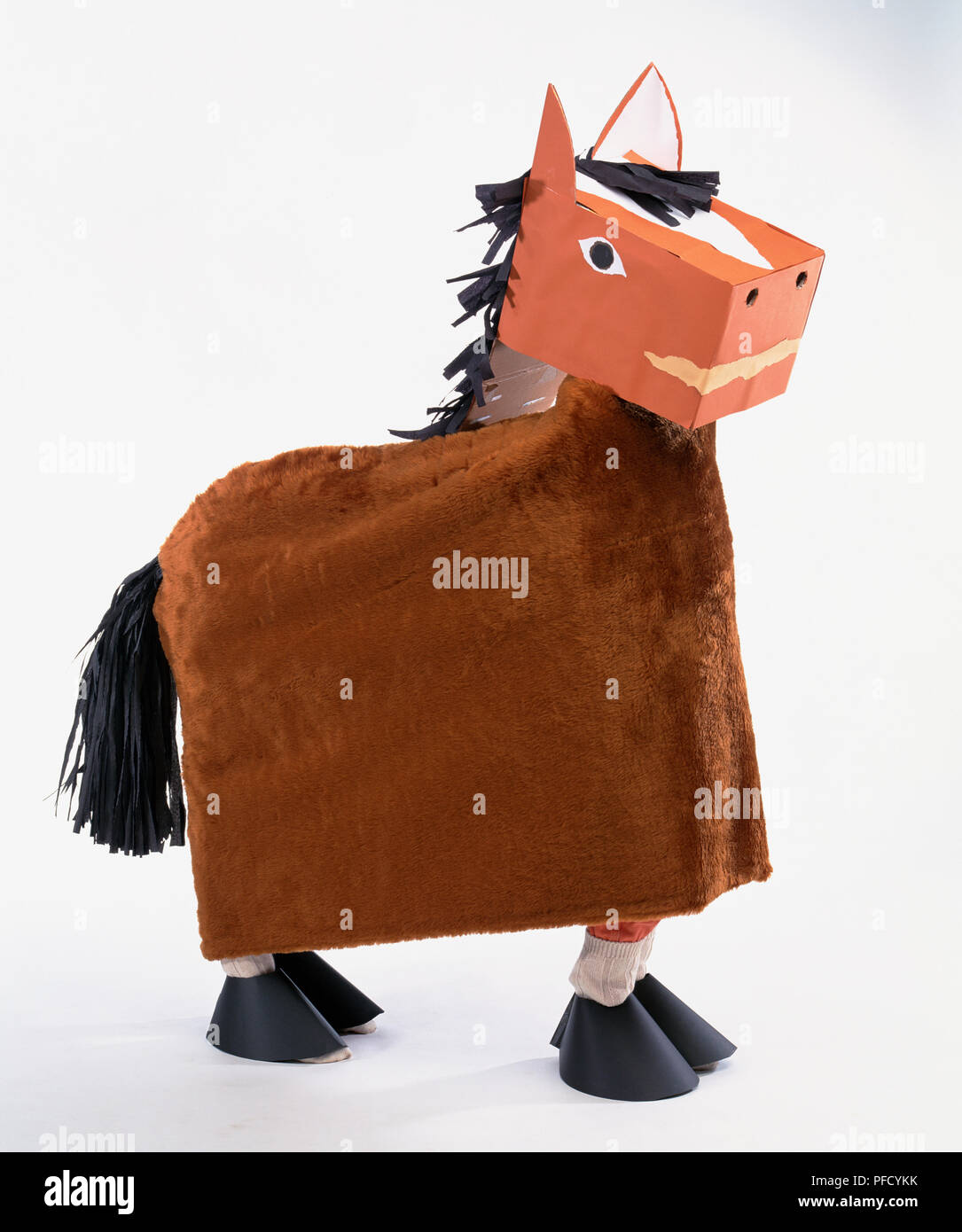 Two Children Wearing Horse Costume One Standing Behind The Other To Form Body And All Four Legs Brown Horse With Black Feet Tail And Mane Box Shaped Head With Eyes Nostrils And Smiling