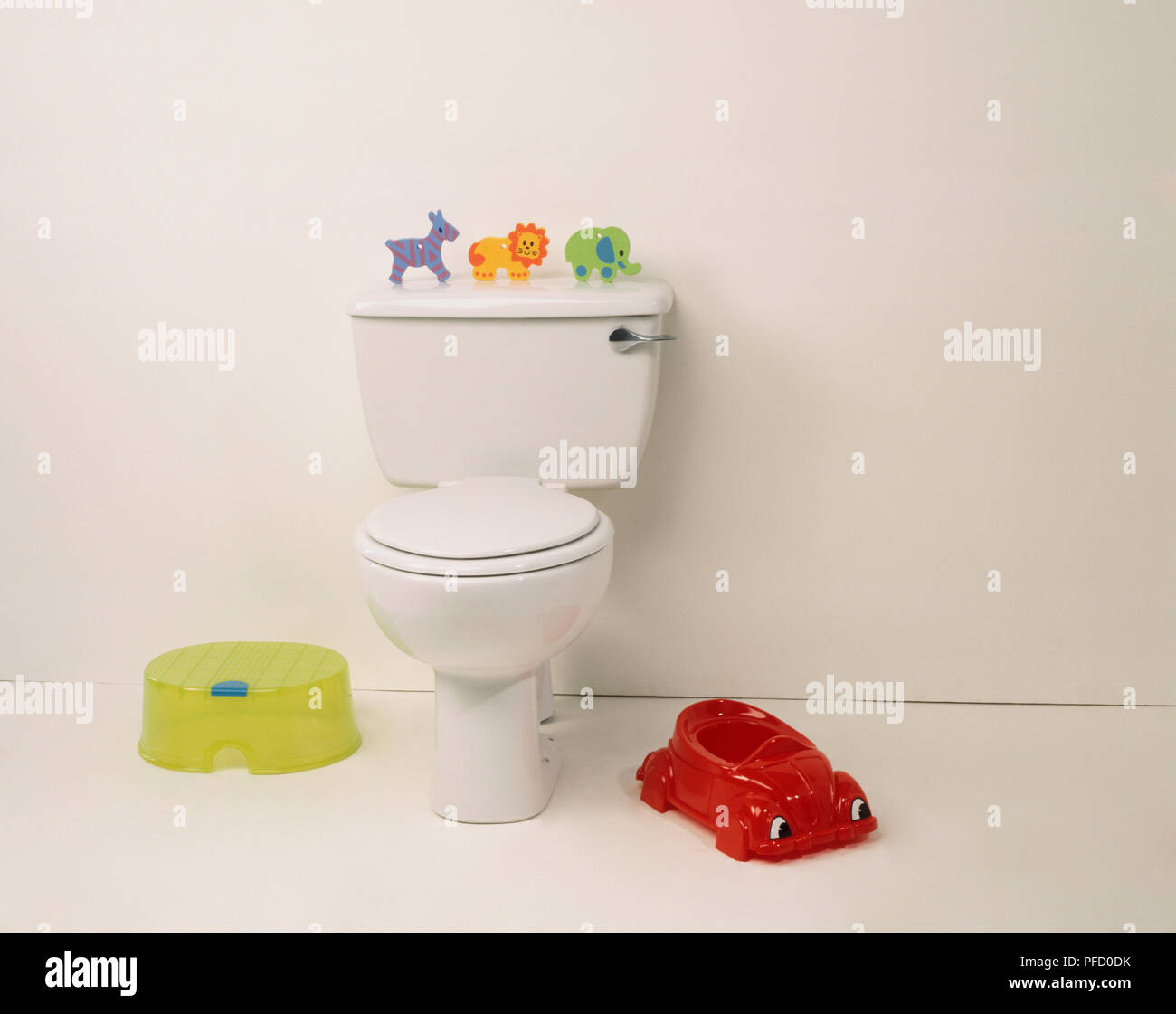 Tremendous White Toilet With Toy Zebra Lion And Elephant Placed On Beatyapartments Chair Design Images Beatyapartmentscom