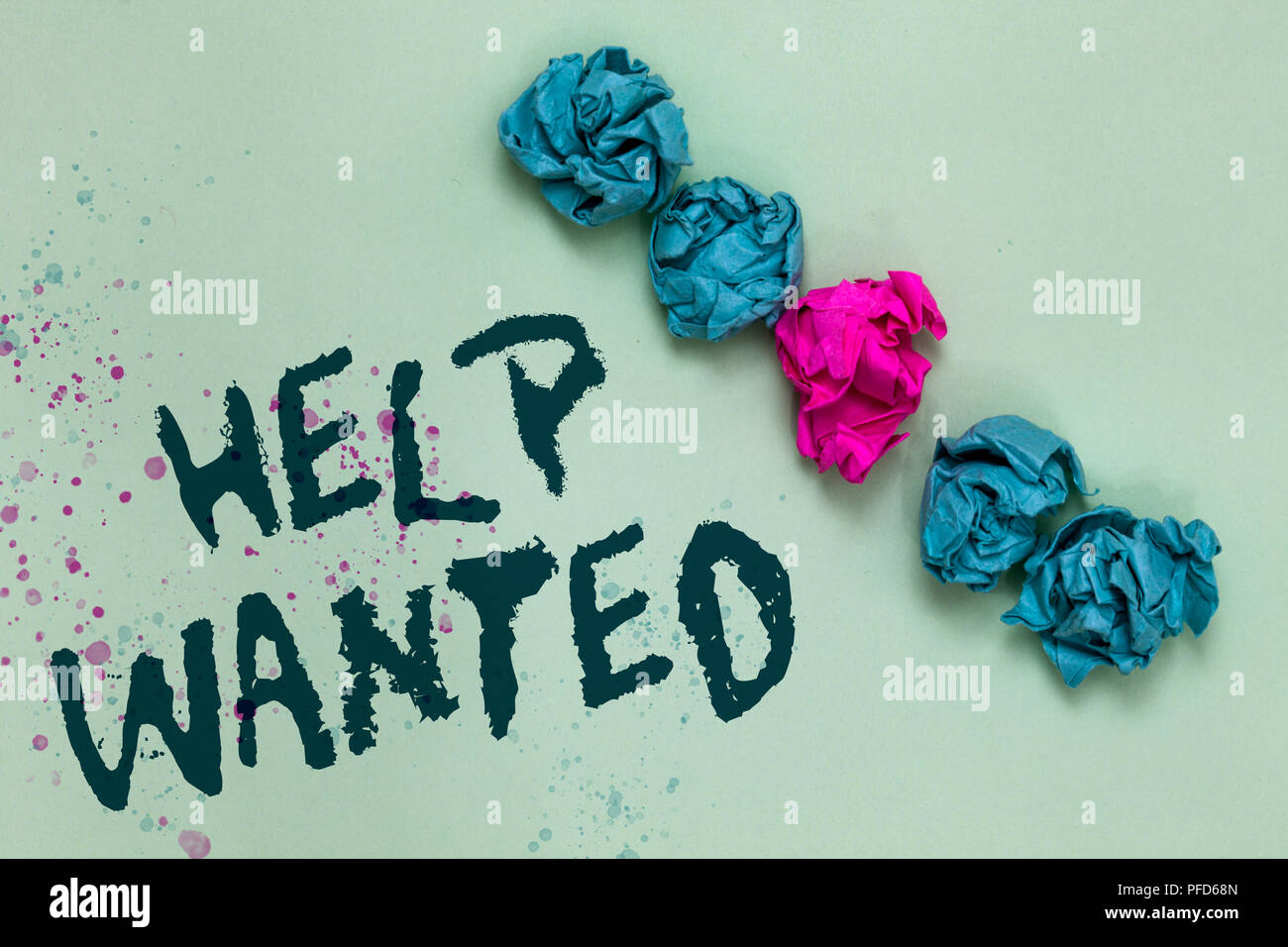 Word writing text Help Wanted. Business concept for advertisement placed in newspaper by employers seek employees Aligned crumpled wrinkled papers one - Stock Image