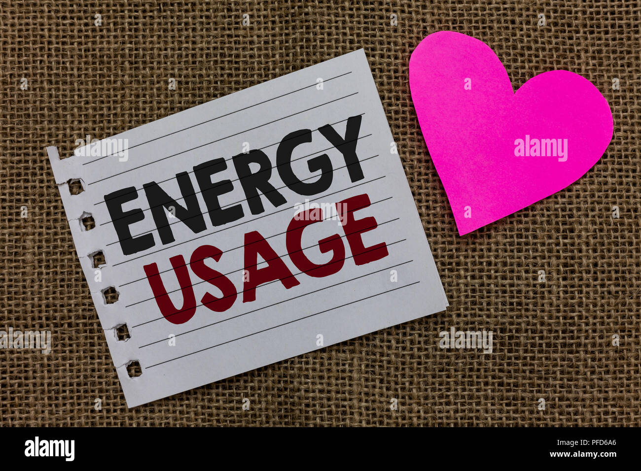 Conceptual hand writing showing Energy Usage. Business photo text Amount of energy consumed or used in a process or system Piece paper Romantic ideas  - Stock Image