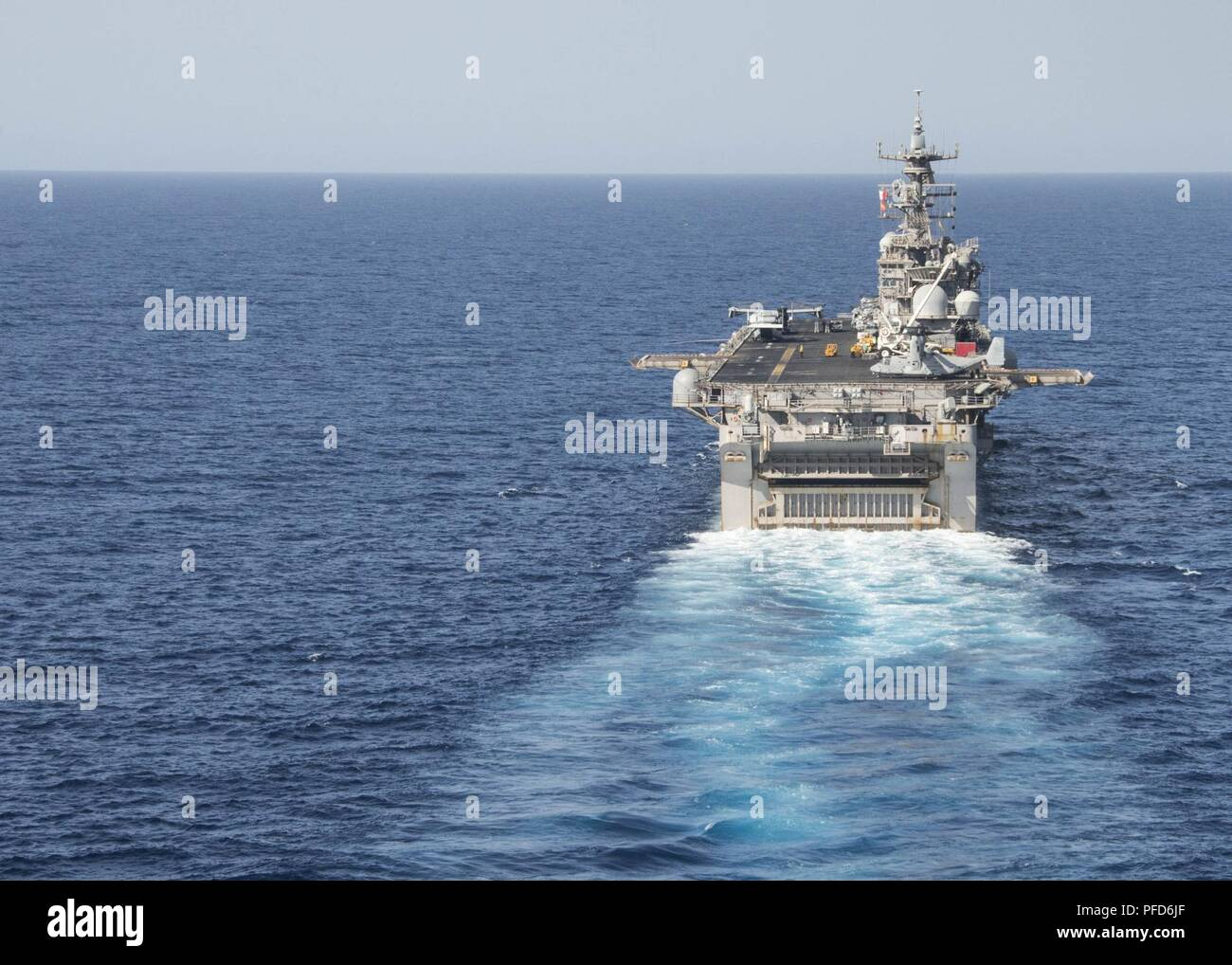 5TH FLEET AREA OF OPERATIONS (June 8, 2018) The Wasp-class amphibious assault ship USS Iwo Jima (LHD 7) steams in the 5th Fleet Area of Operations, June 8, 2018. Iwo Jima, homeported in Mayport, Fla., is on deployment to the U.S. 5th Fleet area of operations in support of maritime security operations to reassure allies and partners, and preserve the freedom of navigation and the free flow of commerce in the region. Stock Photo