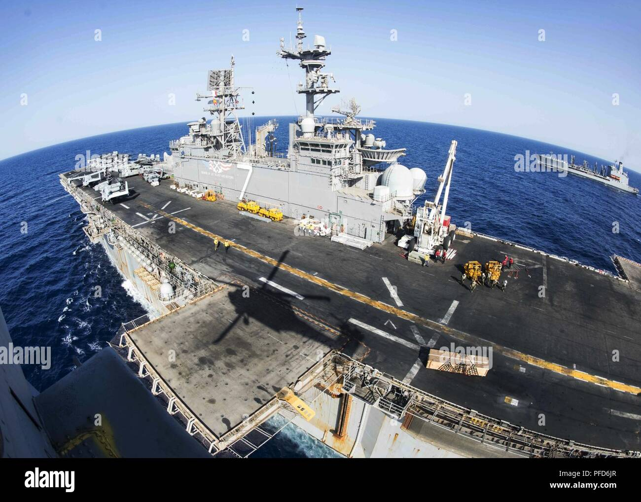 5TH FLEET AREA OF OPERATIONS (June 8, 2018) The Wasp-class amphibious assault ship USS Iwo Jima (LHD 7), front, conducts a replenishment-at-sea with the fleet replenishment oiler USNS Big Horn (T-AO 198), June 8, 2018. Iwo Jima, homeported in Mayport, Fla., is on deployment to the U.S. 5th Fleet area of operations in support of maritime security operations to reassure allies and partners, and preserve the freedom of navigation and the free flow of commerce in the region. Stock Photo