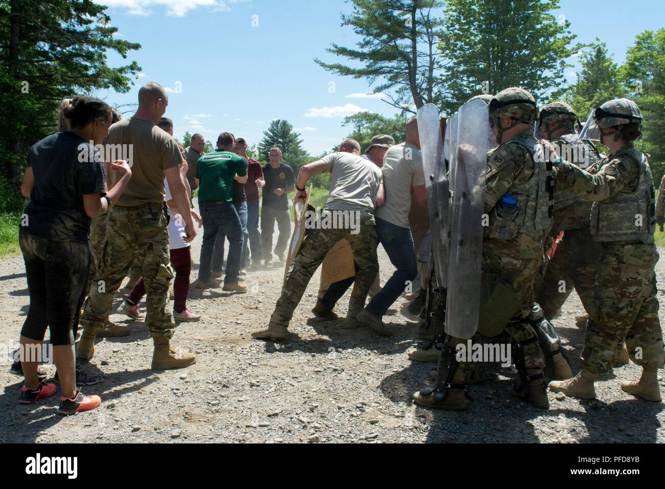 The civil disturbance turns violent and the 488th Military Police Company's quick reaction force holds the line.  The QRF was used during civil disturbance exercise as part of the MP's National Guard Reaction Force evaluation at Plymouth Training Area, June 2, 2018. (Maine Army National Guard - Stock Image