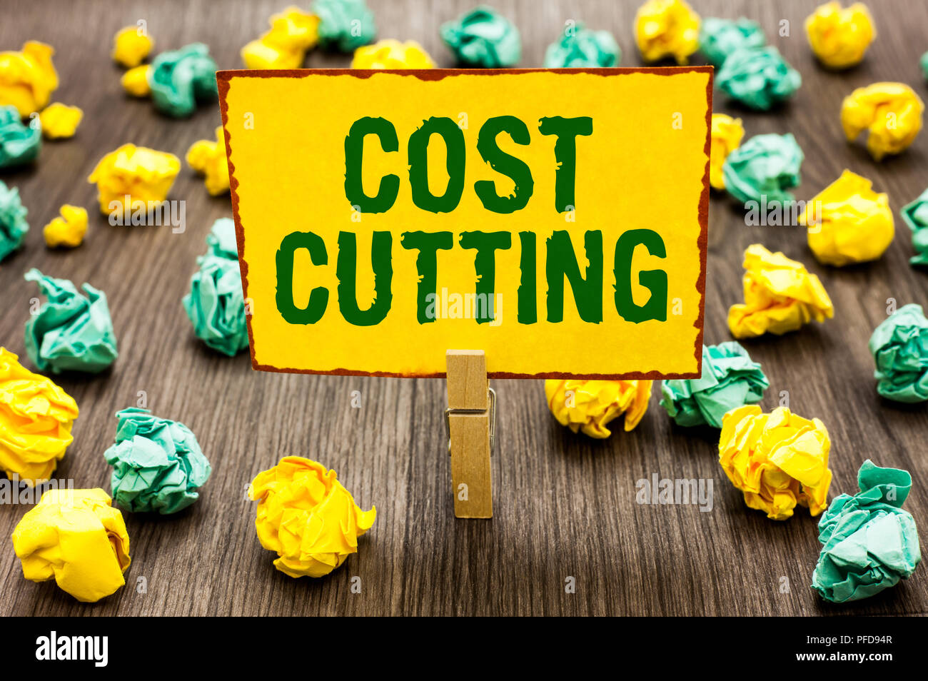 Conceptual hand writing showing Cost Cutting. Business photo text Measures implemented to reduced expenses and improved profit Clothespin holding yell - Stock Image