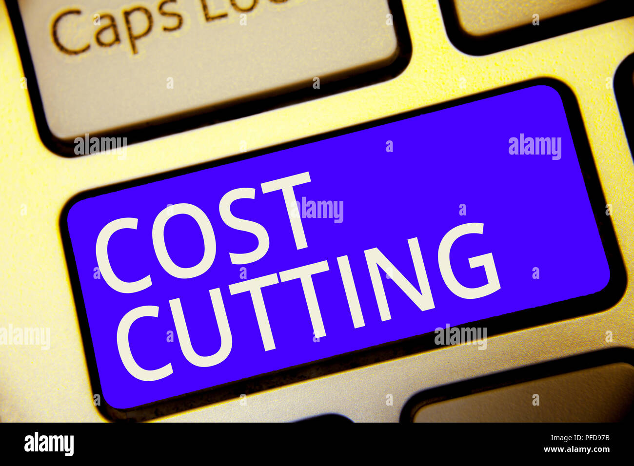 Conceptual hand writing showing Cost Cutting. Business photo showcasing Measures implemented to reduced expenses and improved profit Keyboard blue key - Stock Image