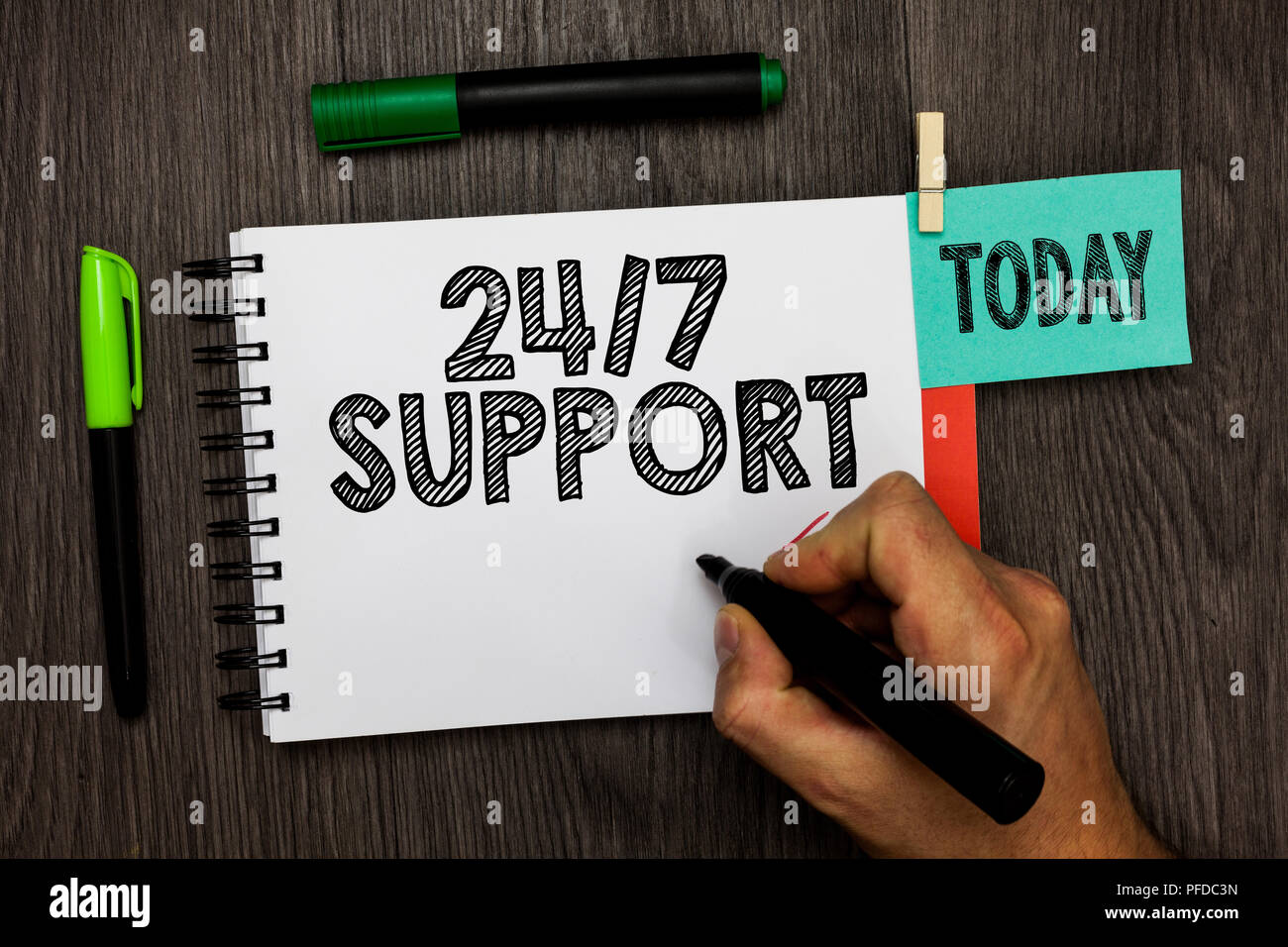 Conceptual hand writing showing 24 7 Support. Business photo showcasing Giving assistance to service whole day and night No downtime Man holding marke - Stock Image