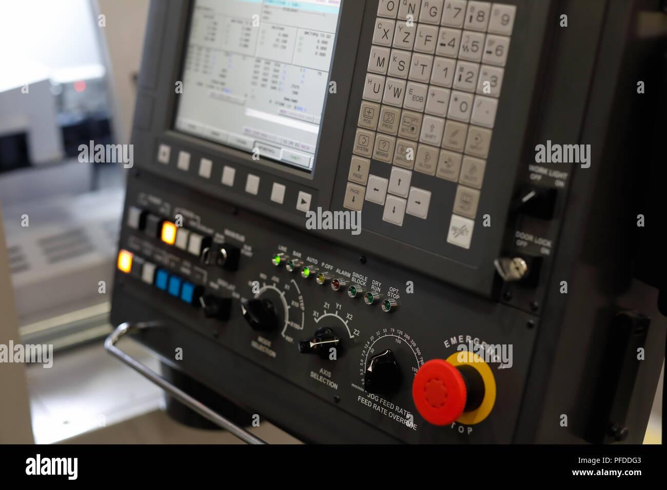 CNC control panel of metalworking machining center. Selective focus. - Stock Image