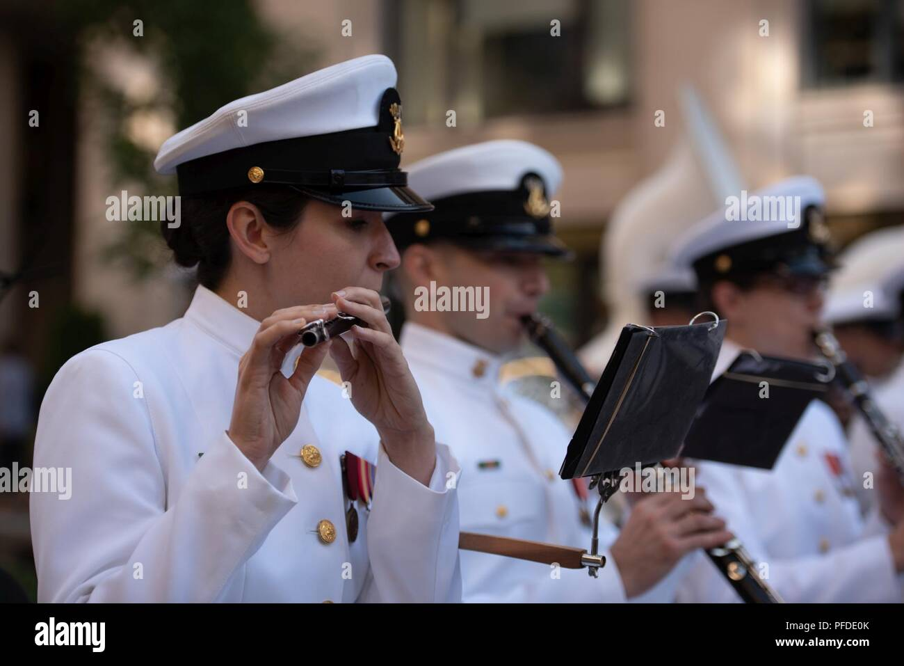 WASHINGTON (June 5, 2018) Musician 1st Class Brittany Foster, piccolo instrumentalist with the U.S. Navy Ceremonial band performs at the U.S. Navy Memorial in Washington, D.C., during the commemoration of the 76th anniversary of the Battle of Midway. The Battle of Midway began on June 4 in 1942 and stands as one of the U.S. Navy's most historically significant naval battles. Fought on the high seas of the Pacific more than half a century ago, this battle altered the course of the war in the Pacific and thereby shaped the outcome of world events. - Stock Image