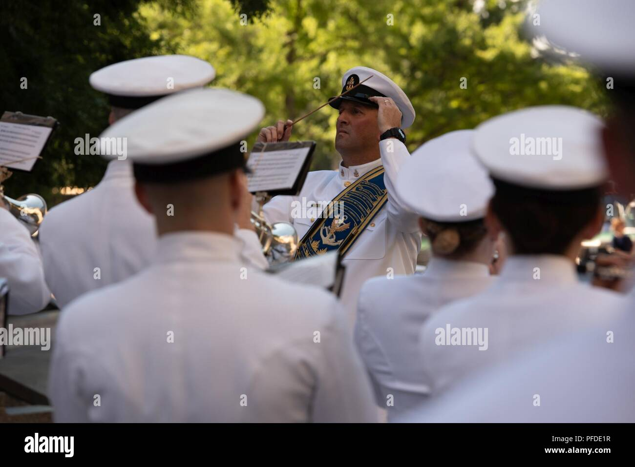 WASHINGTON (June 5, 2018) Senior Chief Musician Michael Bayes, drum major of the U.S. Navy Ceremonial band leads the band at the U.S. Navy Memorial in Washington, D.C., during the commemoration of the 76th anniversary of the Battle of Midway. The Battle of Midway began on June 4 in 1942 and stands as one of the U.S. Navy's most historically significant naval battles. Fought on the high seas of the Pacific more than half a century ago, this battle altered the course of the war in the Pacific and thereby shaped the outcome of world events. - Stock Image