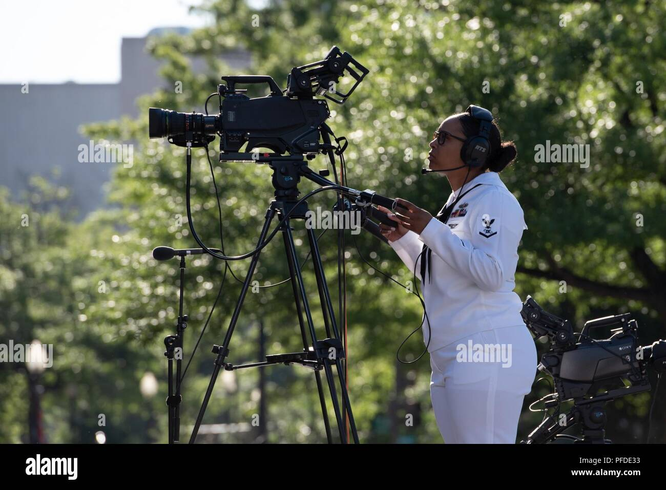 WASHINGTON (June 5, 2018) Mass Communications Specalist 3rd Class Briana Bowens videotapes the commemoration of the 76th anniversary of the Battle of Midway at the U.S. Navy Memorial in Washington, D.C. The Battle of Midway stands as one of the U.S. Navy's most historically significant naval battles. Fought on the high seas of the Pacific more than half a century ago, this battle altered the course of the war in the Pacific and thereby shaped the outcome of world events. - Stock Image