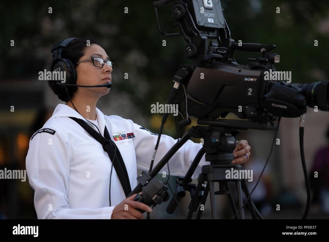 WASHINGTON (June 5, 2018) Mass Communications Specalist 2nd Class Anita Newman videotapes the commemoration of the 76th anniversary of the Battle of Midway at the U.S. Navy Memorial in Washington, D.C. The Battle of Midway stands as one of the U.S. Navy's most historically significant naval battles. Fought on the high seas of the Pacific more than half a century ago, this battle altered the course of the war in the Pacific and thereby shaped the outcome of world events. - Stock Image