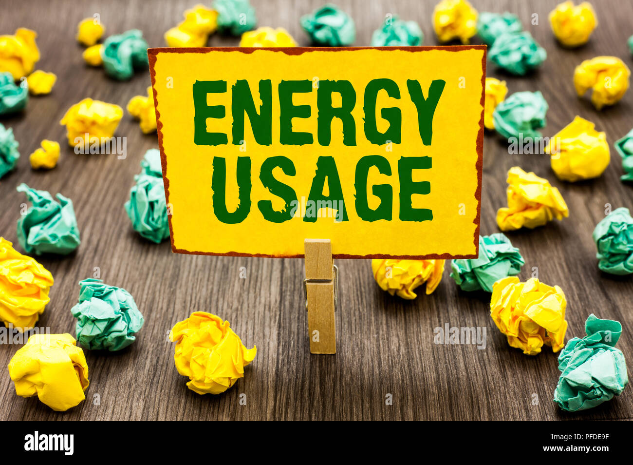 Conceptual hand writing showing Energy Usage. Business photo text Amount of energy consumed or used in a process or system Clothespin holding yellow n - Stock Image
