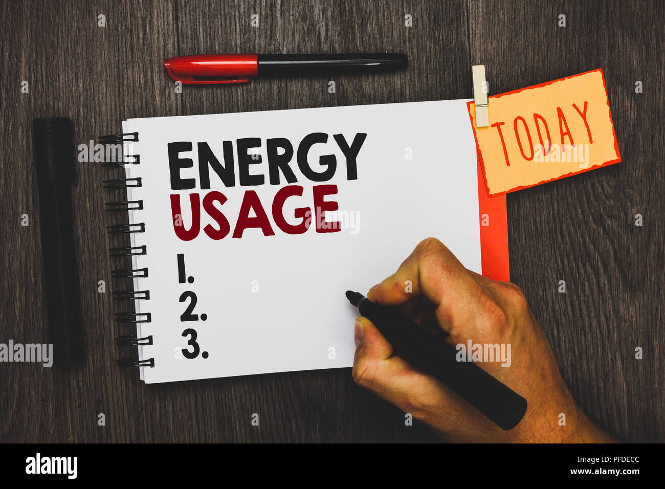 Text sign showing Energy Usage. Conceptual photo Amount of energy consumed or used in a process or system Man holding marker notebook clothespin hold  - Stock Image