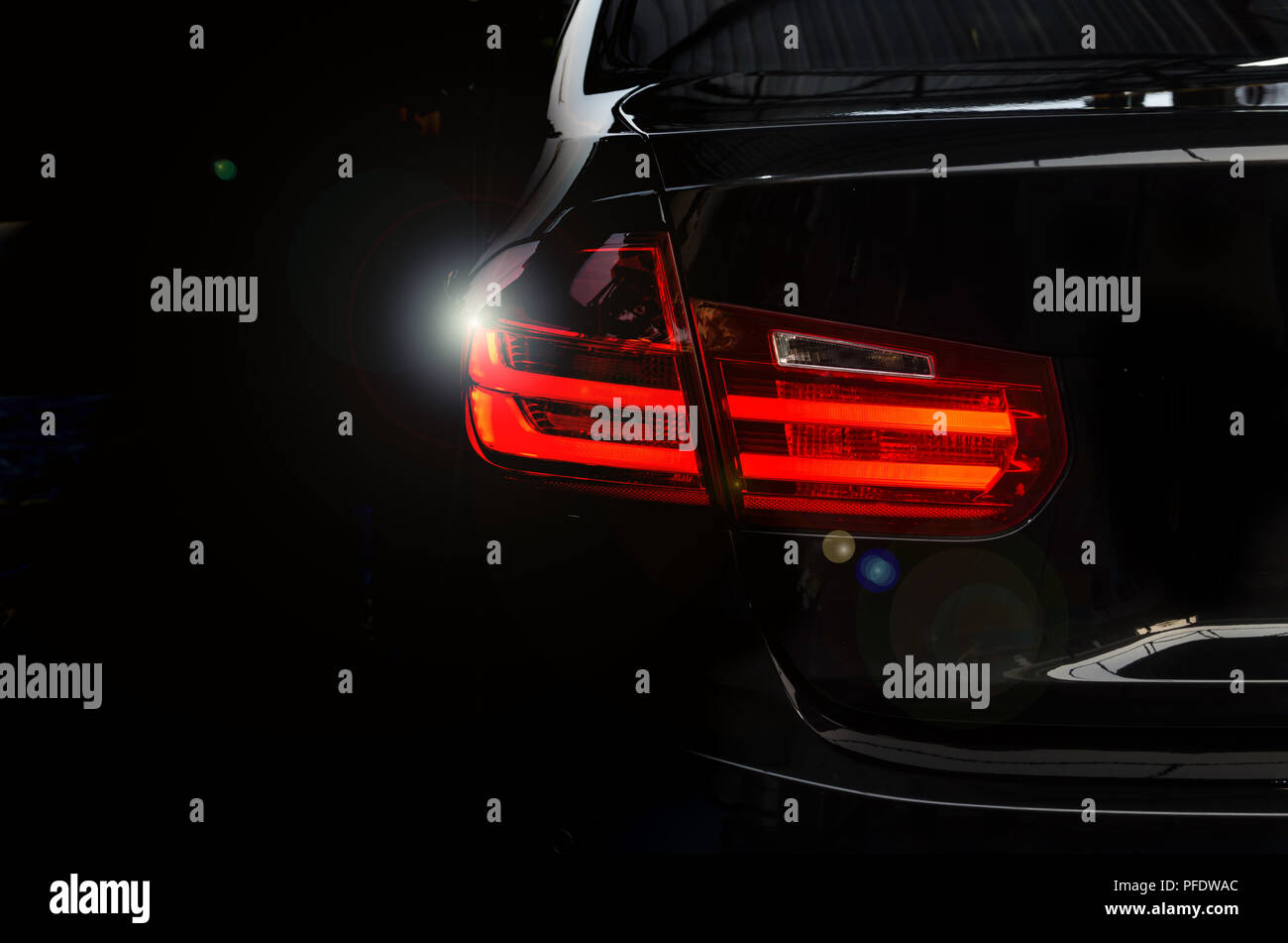 Luxury Car Tail Light On A Black Background Stock Photo 216049524
