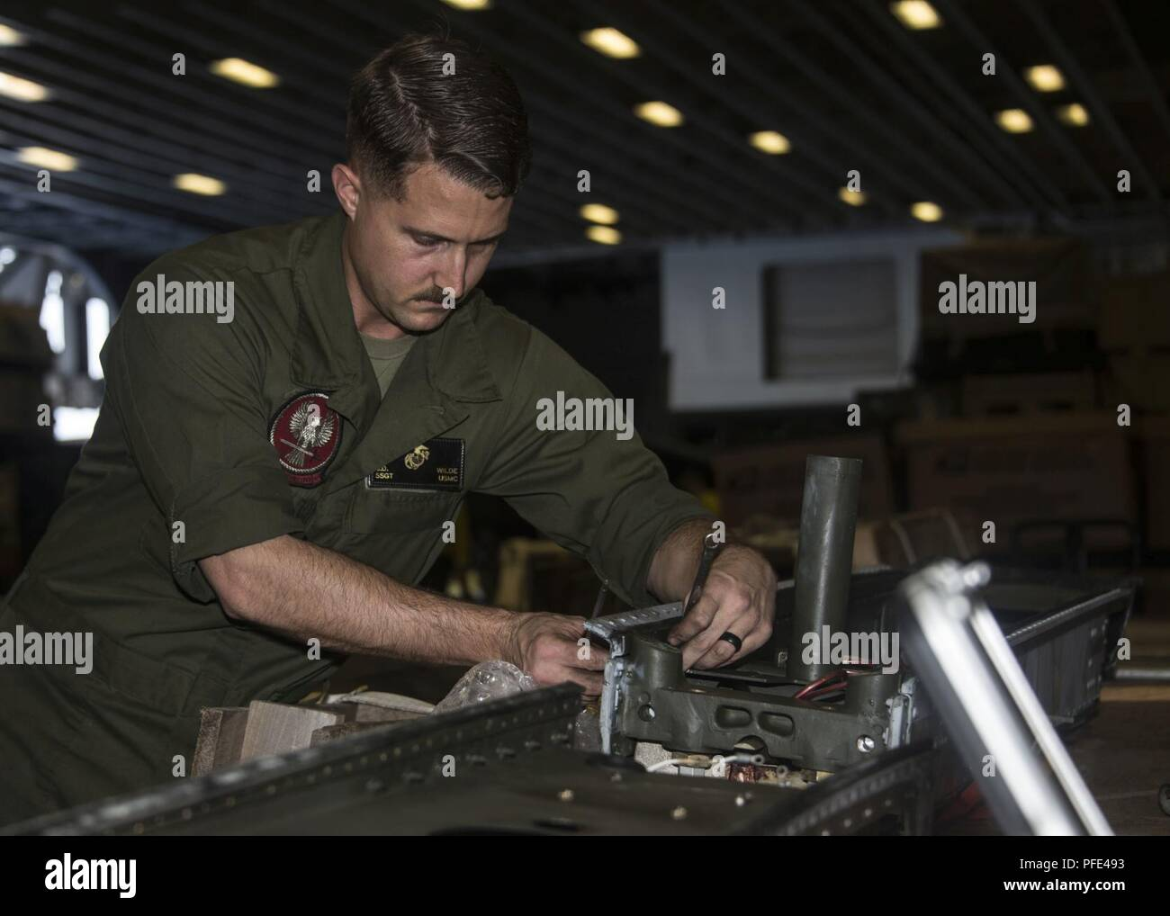 5TH FLEET AREA OF OPERATIONS (June 9, 2018) U.S. Marine Corps Staff Sgt. Steven Wilde, assigned to the 26th Marine Expeditionary Unit's Aviation Combat Element, performs maintenance on a fuel sponson in the hangar bay aboard the Wasp-class amphibious assault ship USS Iwo Jima (LHD 7), June 9, 2018. Iwo Jima, homeported in Mayport, Fla., is on deployment to the U.S. 5th Fleet area of operations in support of maritime security operations to reassure allies and partners, and preserve the freedom of navigation and the free flow of commerce in the region. Stock Photo