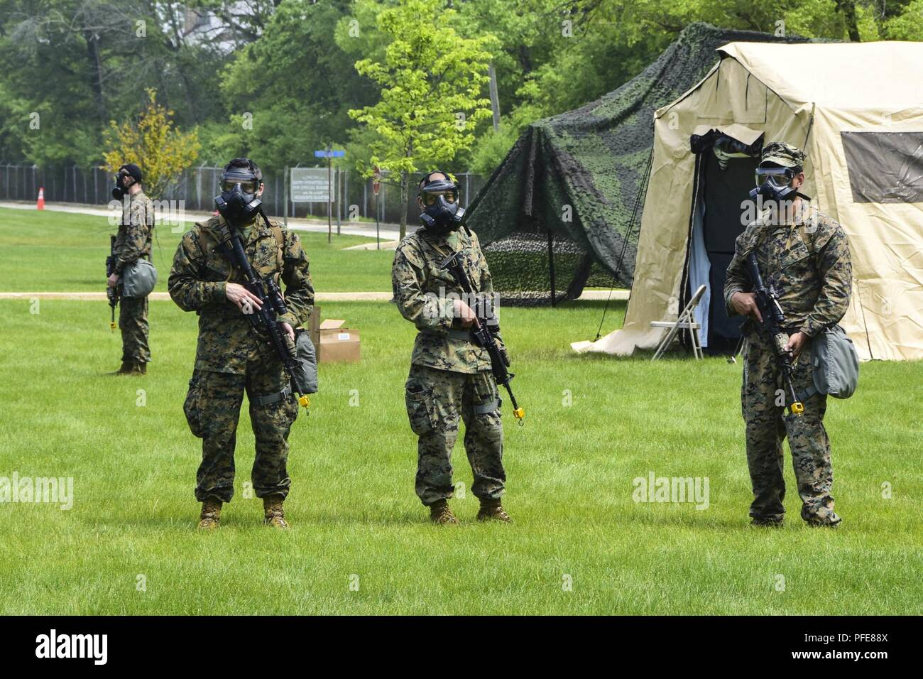 https www alamy com great lakes ill june 9 2018 a group of marines attached to 3d civil affairs group cag stand watch with gas masks on during a training exercise on naval station great lakes each of the 3d cags four operational detachments encountered local civilians who they would encounter in a combat situation who were played by role players a mix of sailors and contractors image216058106 html