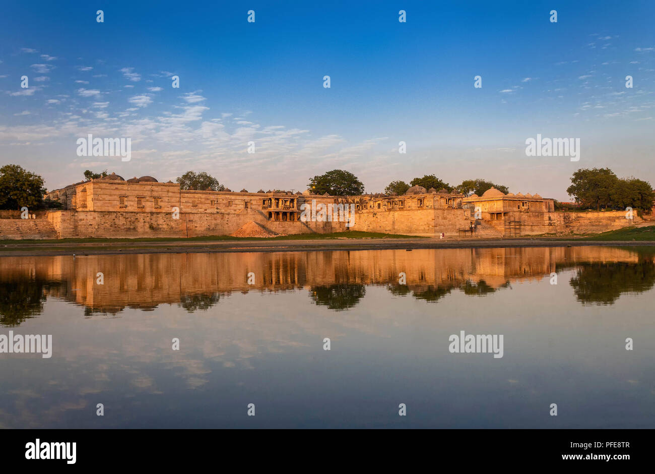 Ahmedabad,Gujarat,India, December 08,2014  A View Of Ancient Mosque And Tomb Complex Across Water In Sarkhej Roza.. - Stock Image