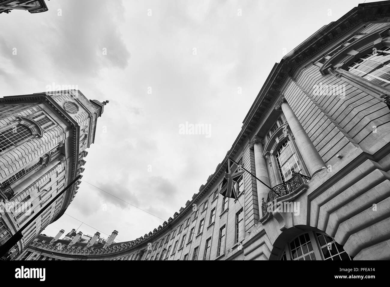 LONDON, UK - JULY 24, 2016: Low angle black and white wide-angle shot of Regent Street building with Union Jack in the lower left. - Stock Image