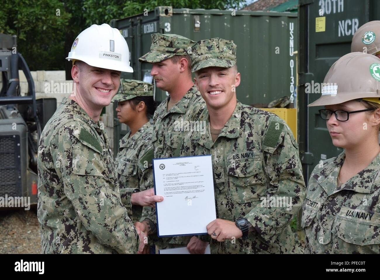 PALAWAN, Philippines (June 7, 2018) Newly frocked Builder 3rd Class Braden Allen poses with Lt.j.g. Michael Pinkston, both assigned to Naval Mobile Construction Battalion (NMCB) 5, during awards and quarters. NMCB 5 is forward deployed to execute construction, humanitarian and foreign assistance, and theater security cooperation in support of United States Pacific Command. Stock Photo