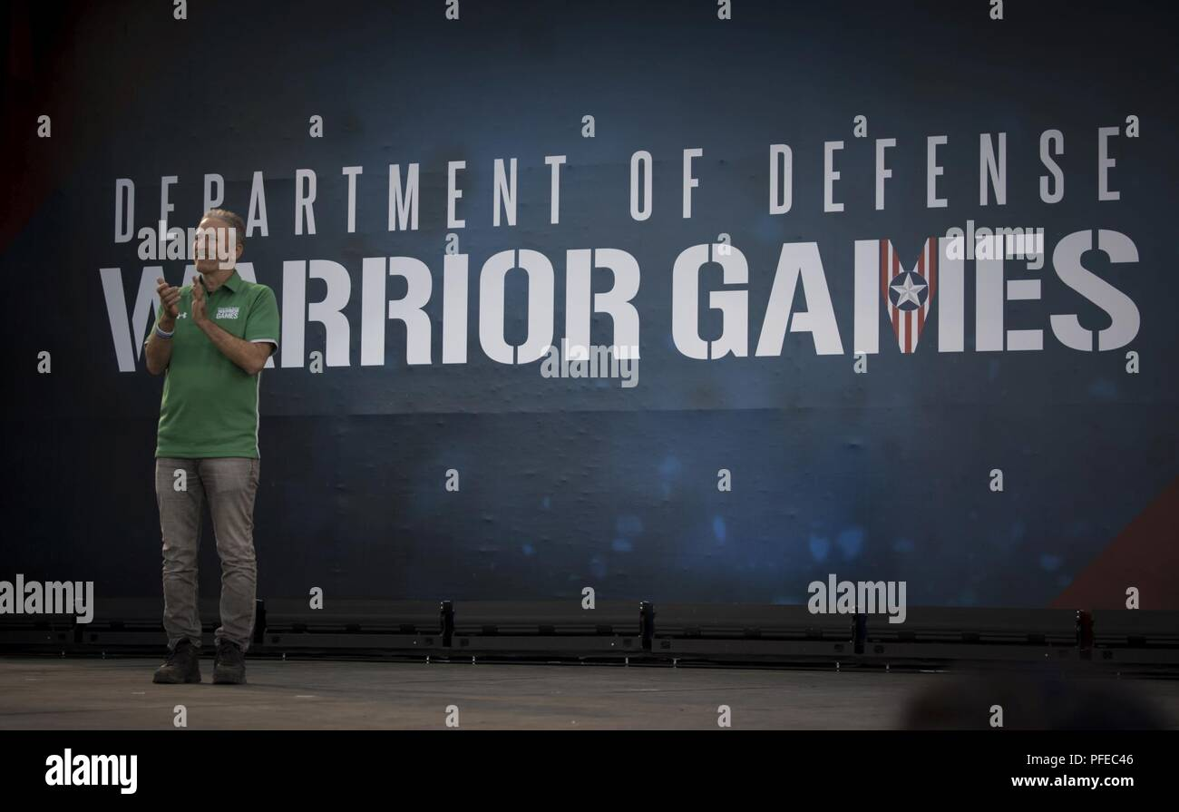 Jon Stewart, television personality and host of the Department of Defense Warrior Games Opening Ceremony, stands on stage during the event in Colorado Springs, Colorado, June 2, 2018.  First held in Colorado Springs in 2010, the Warrior Games were established as a way to enhance the recovery and rehabilitation of wounded, ill, and injured service members and expose them to adaptive sports. This year, the Games have returned to Colorado Springs, with the Air Force acting as the host service. - Stock Image