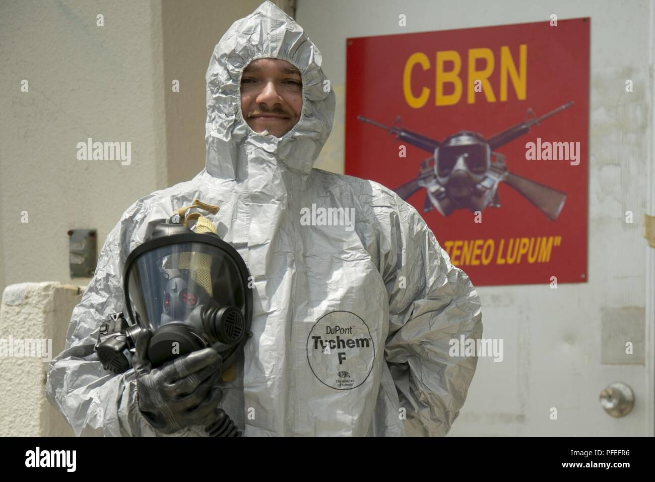 Lance Cpl Joshua Battin Tries On Mission Oriented Protective Posture Gear After An Inventory On