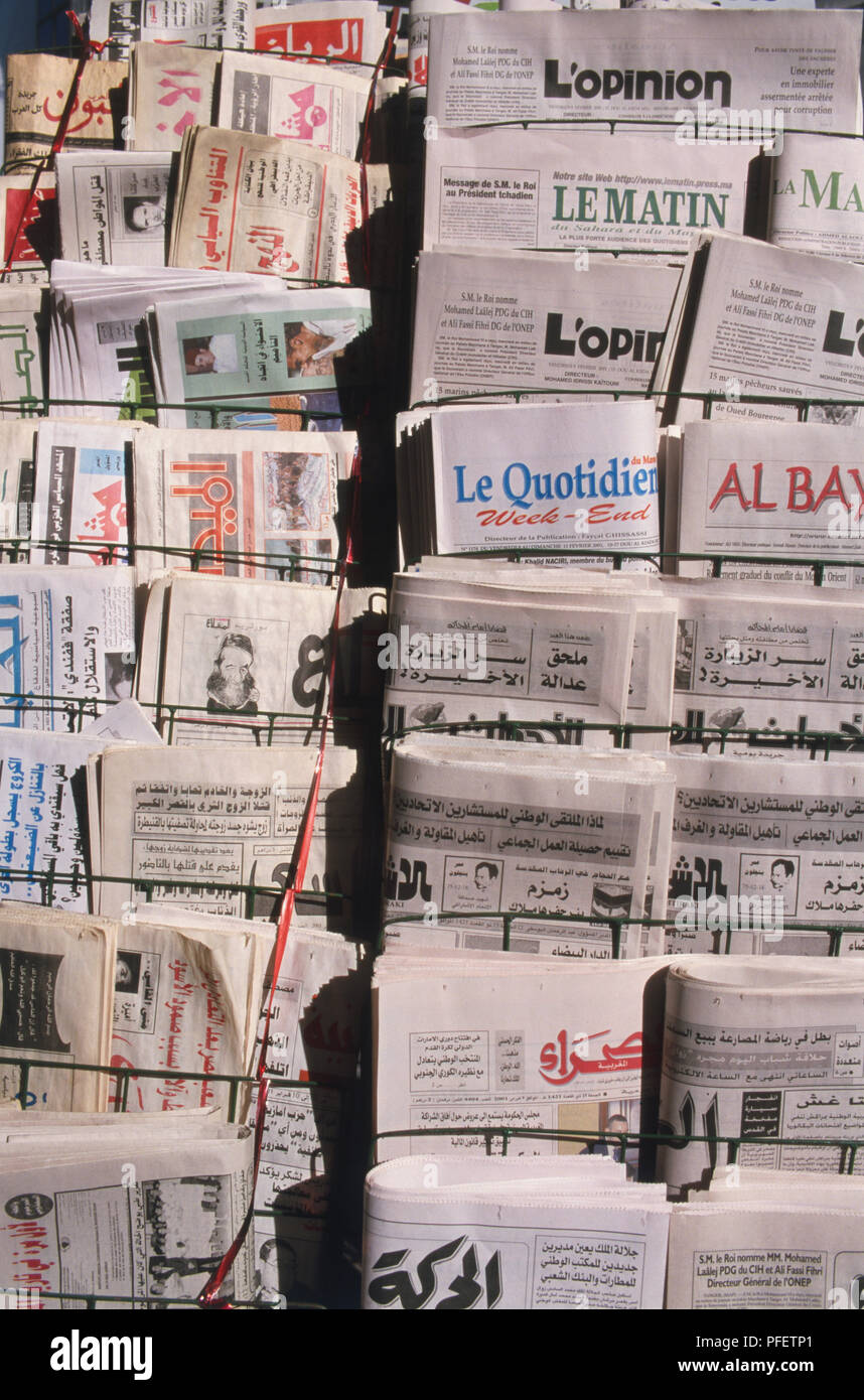 North Africa, Morocco, newspaper vendor's display with newspapers in Latin and Arabic script, close up. - Stock Image
