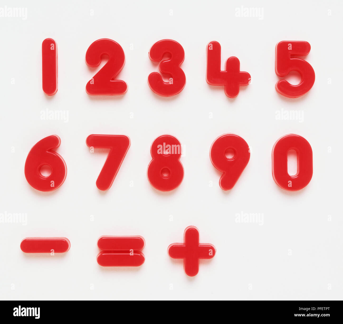 Set of plastic numbers 0 - 9, plus, minus, equals Stock Photo