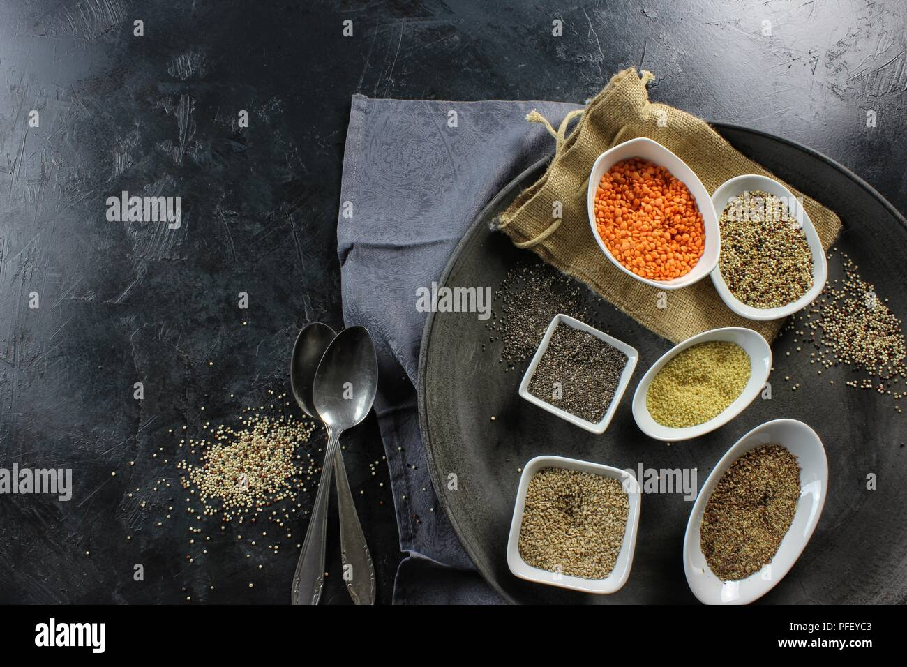 super food in bowls on dark ground - Stock Image