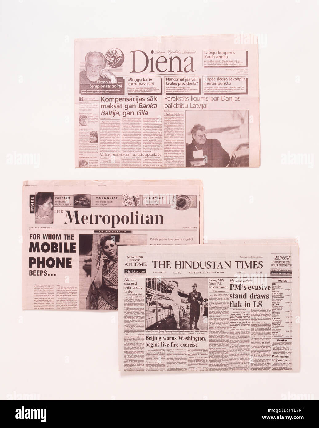 International newspapers, two English language and one Latvian - Stock Image
