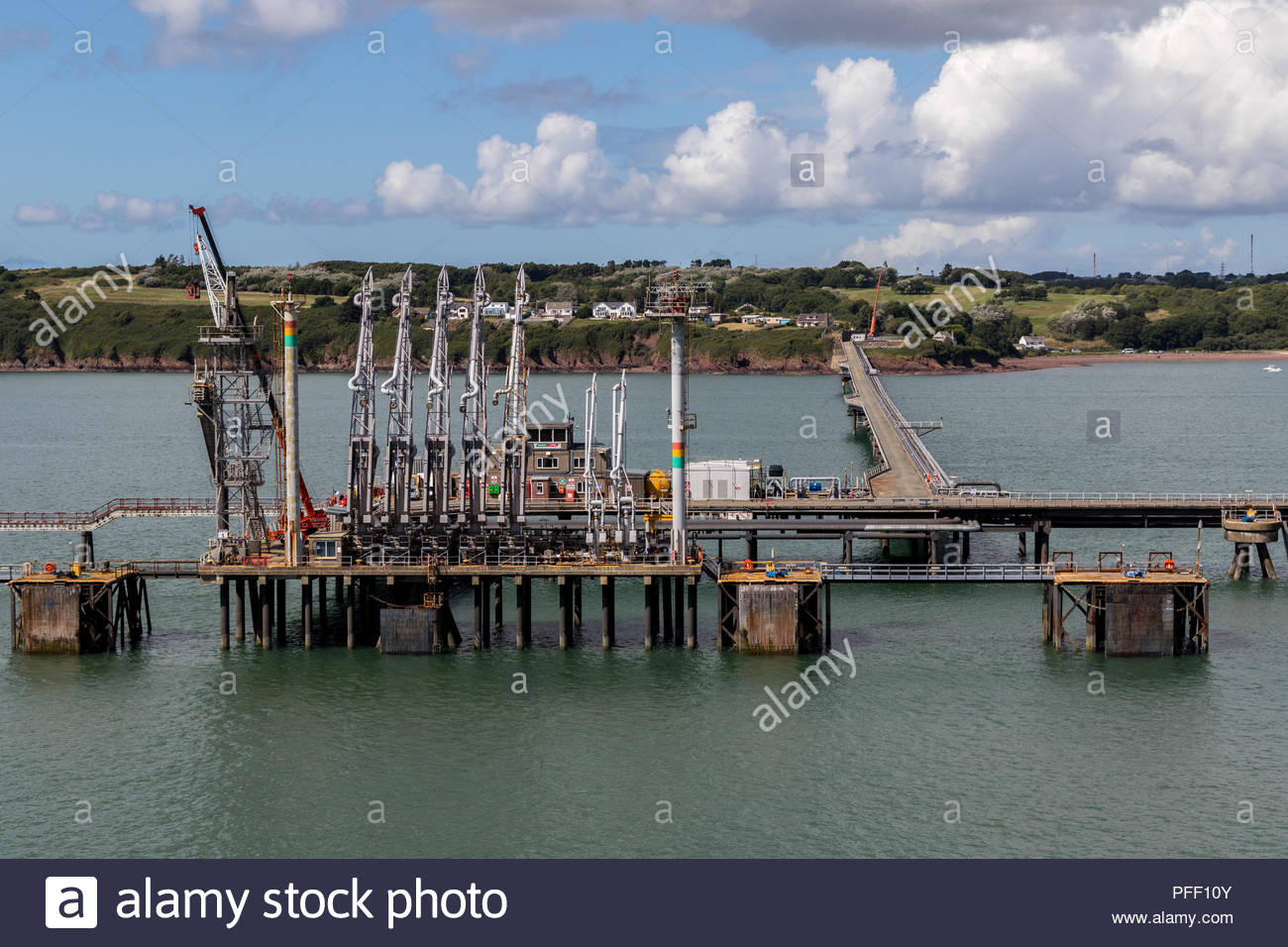Murco Marine  LNG terminals in the waters of Milford Haven, Pembrokeshire with gas storage tanks onshore in the background Stock Photo