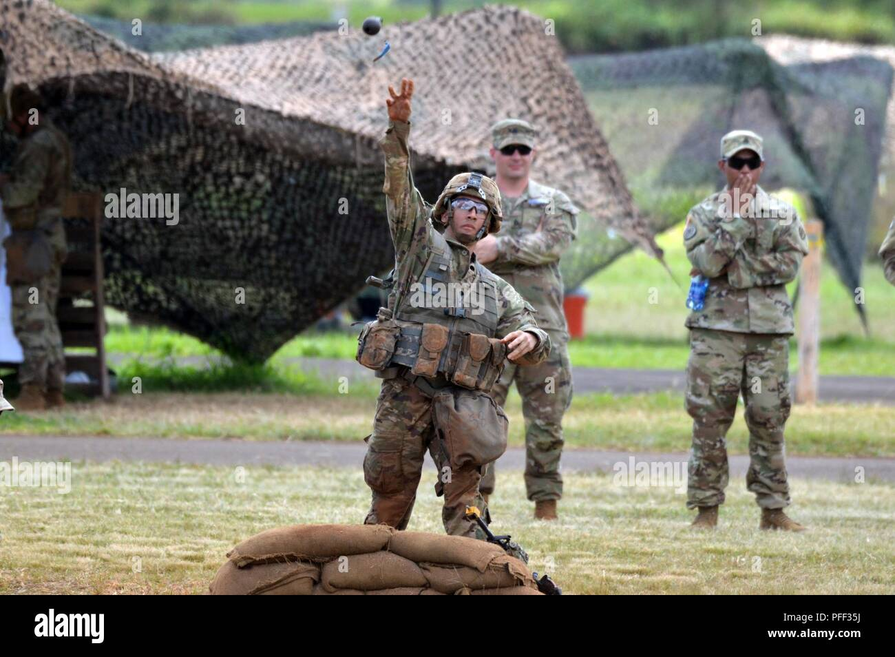A Soldier assigned to the 25th Infantry Division tosses a