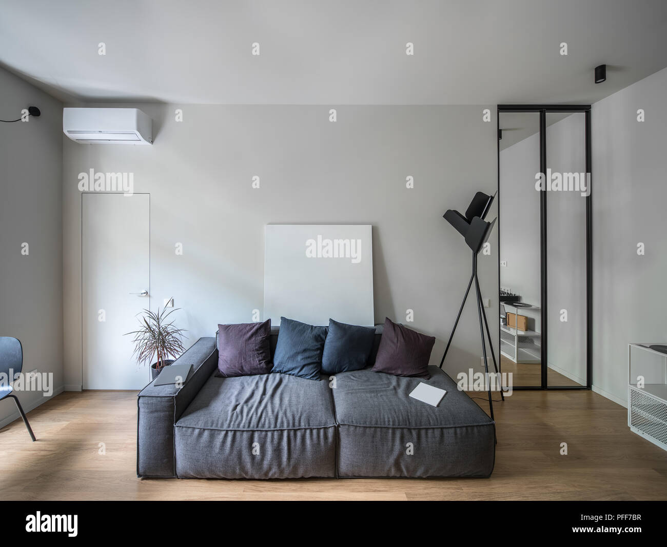 Room In A Modern Style With Light Walls And A Parquet On The Floor