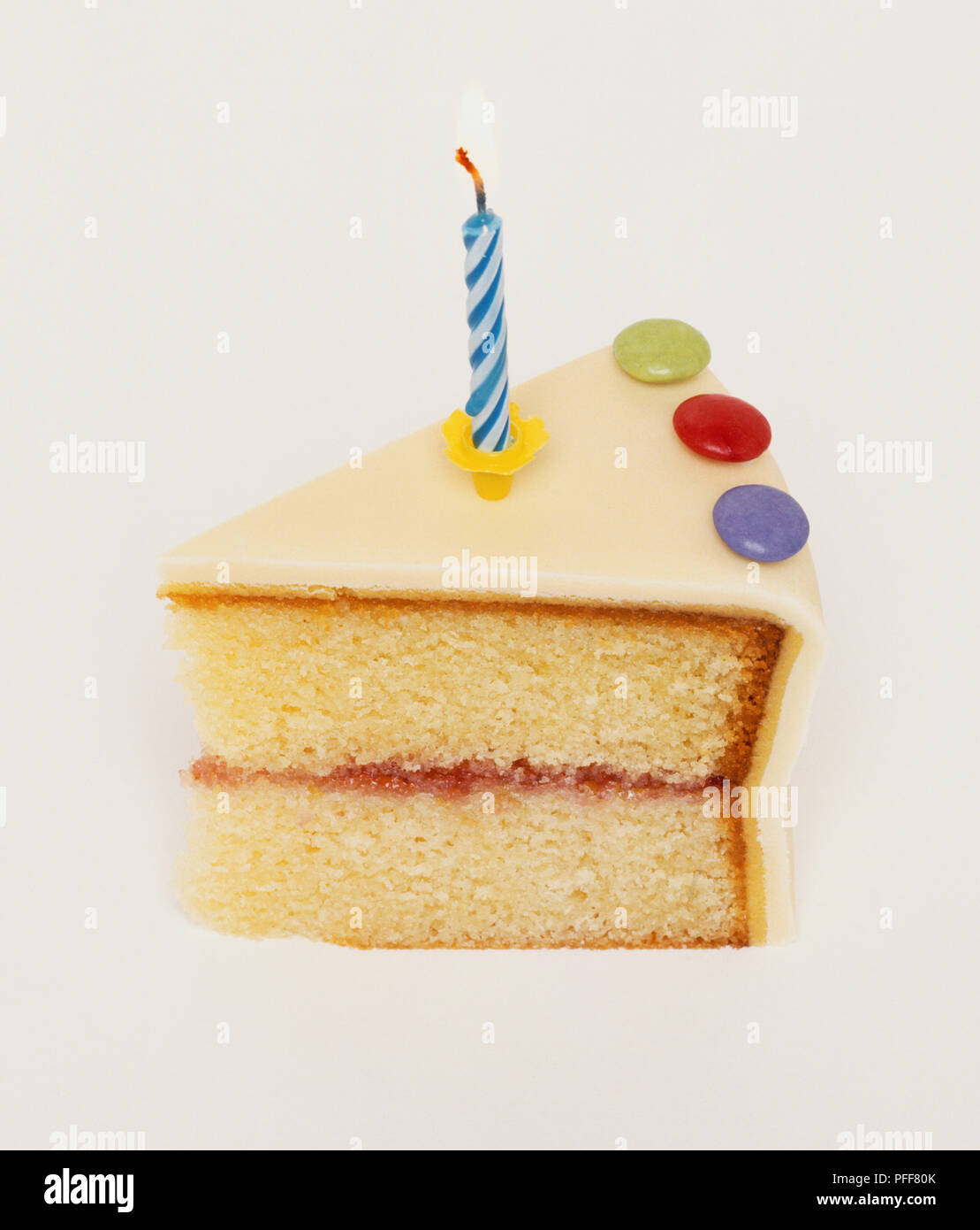 Stupendous Slice Of Birthday Cake With A Blue Candle Stock Photo 216079827 Personalised Birthday Cards Paralily Jamesorg