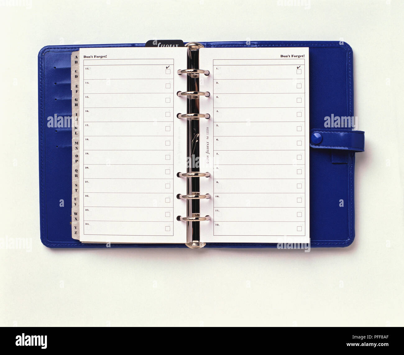 Personal organizer with alphabetical dividers open on 'Don't Forget' page. - Stock Image
