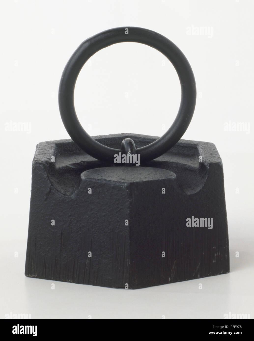 A weight, 1 kilogram mass. - Stock Image