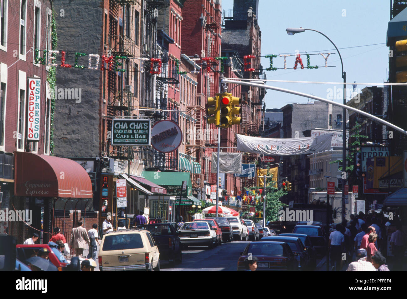 USA, New York, Manhattan, Lower East Side, busy street with Italian restaurants and shops, banner above reading 'Welcome to Little Italy'. - Stock Image