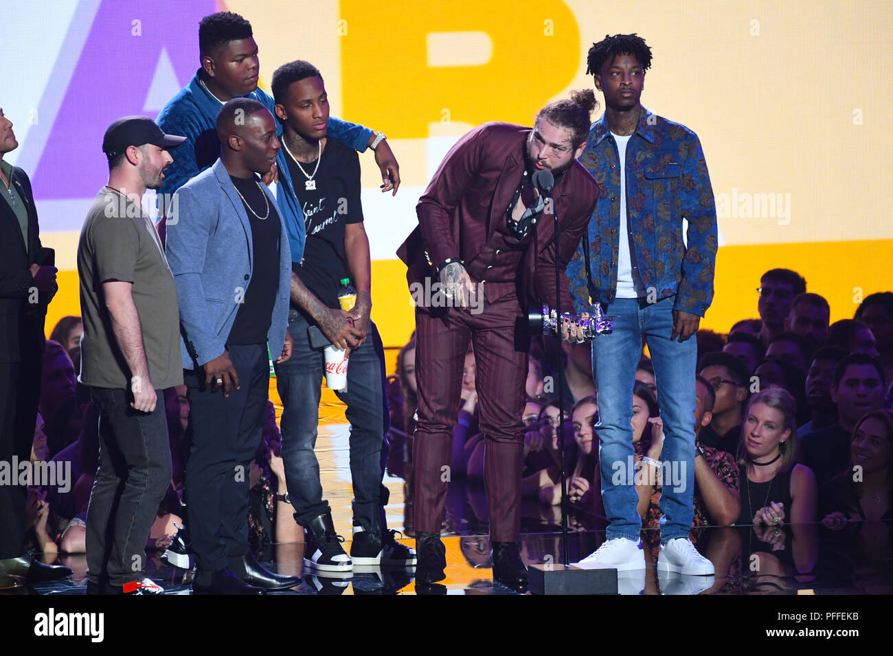 Post Malone accepts the award for Song of the Year on stage