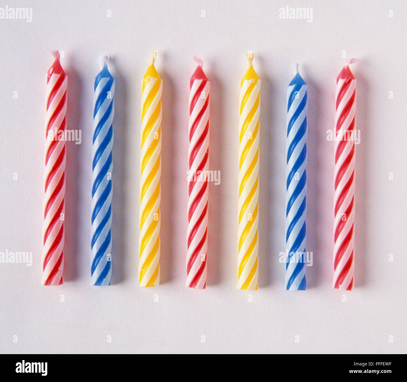Seven small birthday cake candles. - Stock Image