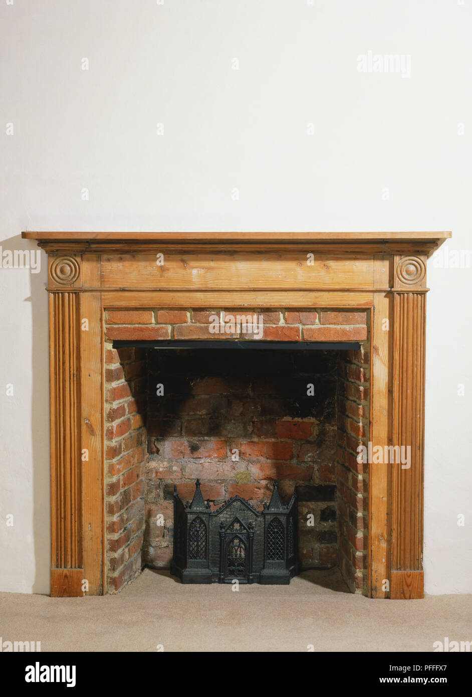 Red Brick Fireplace With A Wooden Frame And Mantlepiece Front