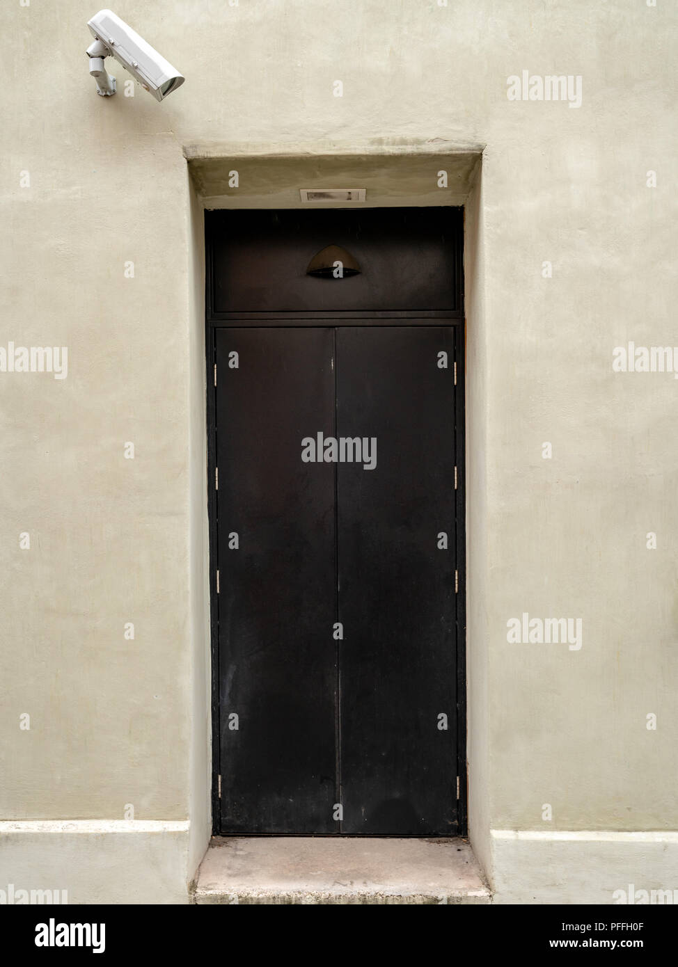 A door with a security camera, seen in Shrewsbury, Shropshire, England, UK - Stock Image