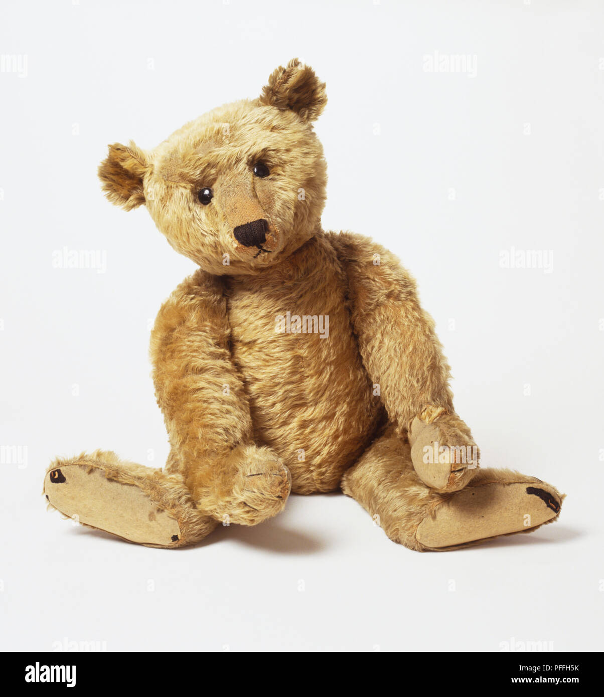c9886e48a21 Pre-1914 Steiff: Sitting yellow teddy bear, front view - Stock Image