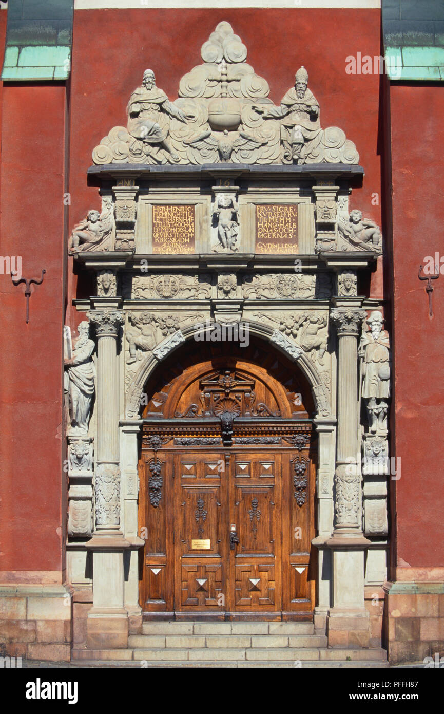Sweden, Stockholm, a beautifully crafted stone porch and wooden door of Jacobs Kyrka, a church started in 1580 and consecrated in 1643 - Stock Image