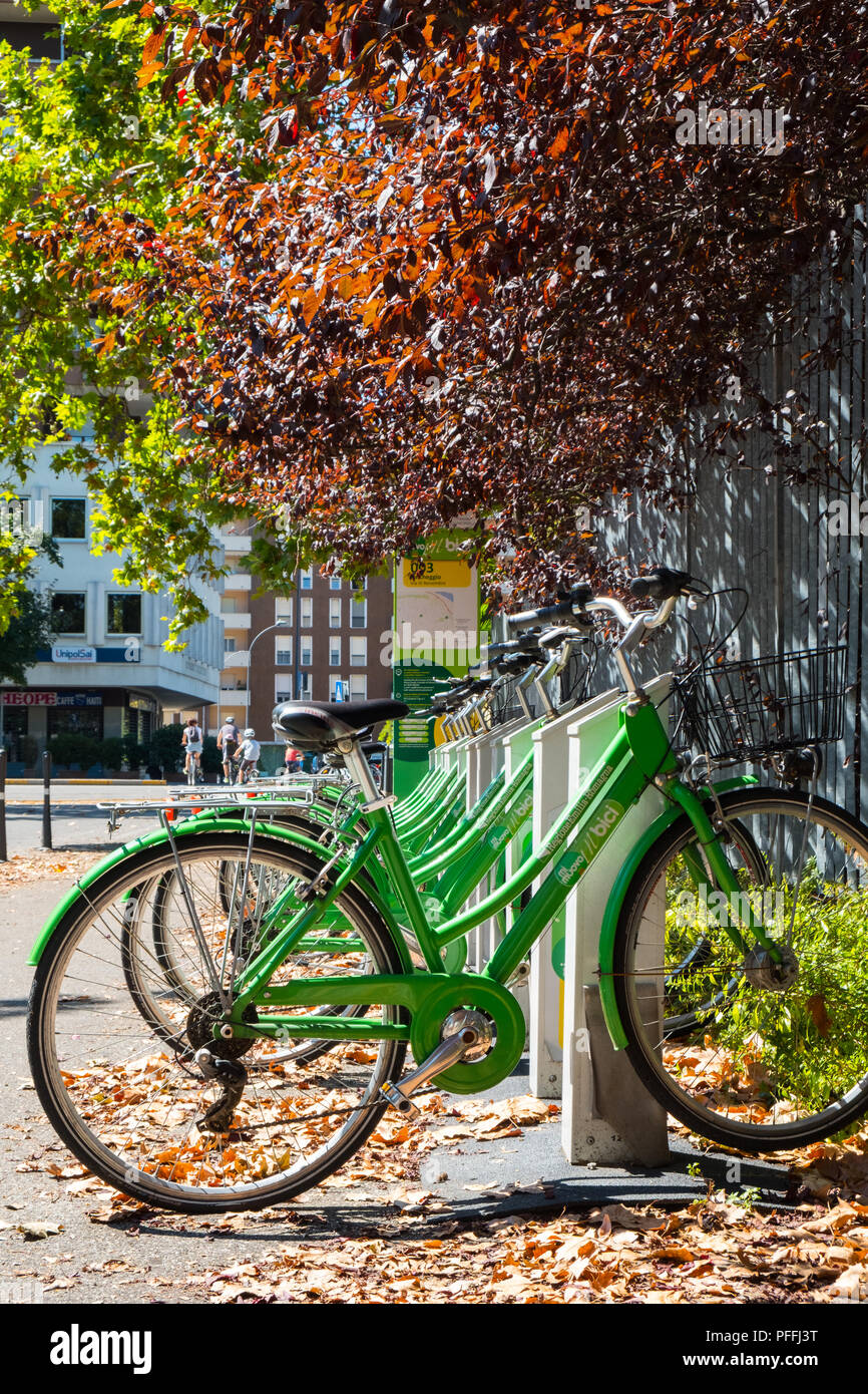 Bike sharing cycling rack dock during summer in Piacenza, Italy Stock Photo