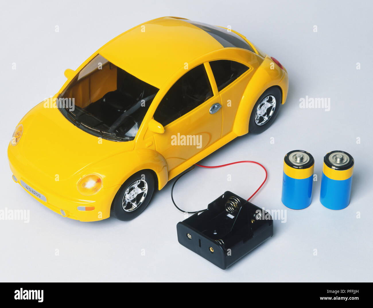 new arrival 66a5a f7044 Yellow toy car connected to empty battery case, two batteries ...