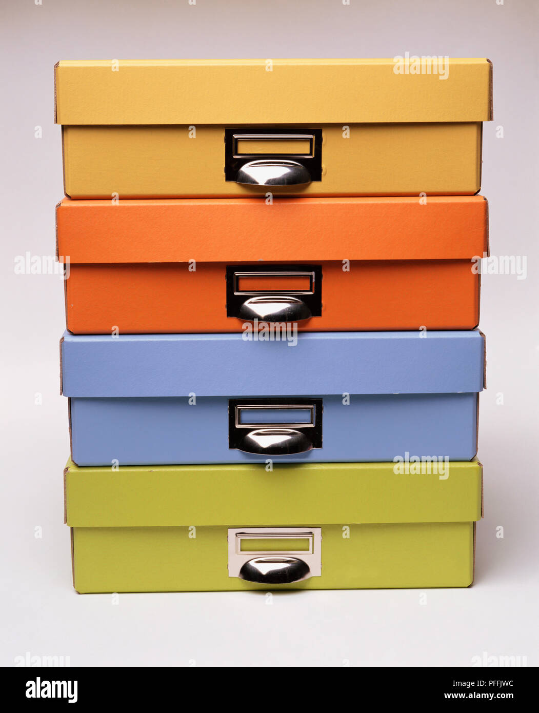 Stacked Coloured Storage Boxes; Yellow, Orange, Blue And ...