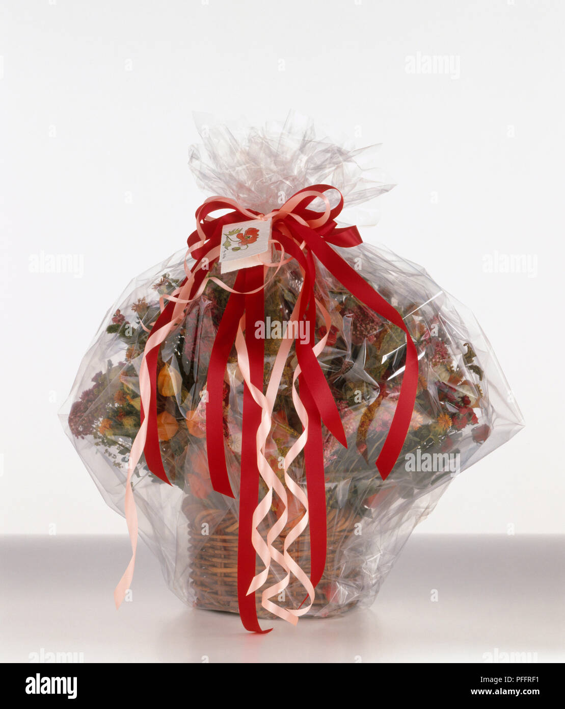 Gift Of Dried Flowers And Pot Pourri In Basket Wrapped In