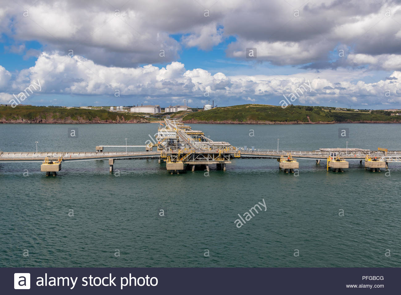 South Hook LNG terminals in the waters of Milford Haven, Pembrokeshire with gas storage tanks onshore in the background Stock Photo