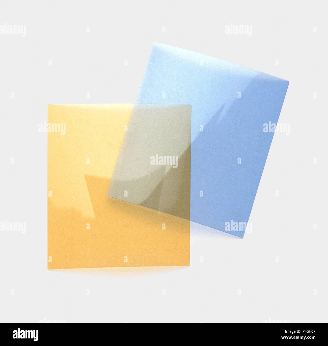 Two pieces of tinted acetate, pale yellow and pale blue - Stock Image