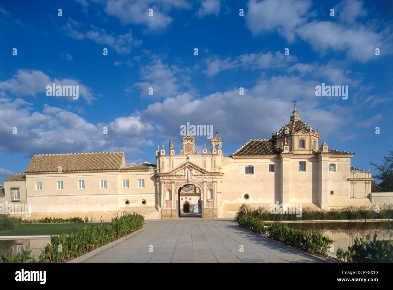 Spain, Seville, facade of the fifteenth century monastery, Carthusian Monasterio de Santa Maria de Las Cuevas. - Stock Image