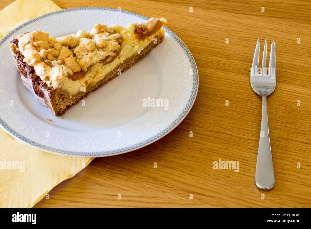 Sweet dessert on the plate with a fork - Stock Image